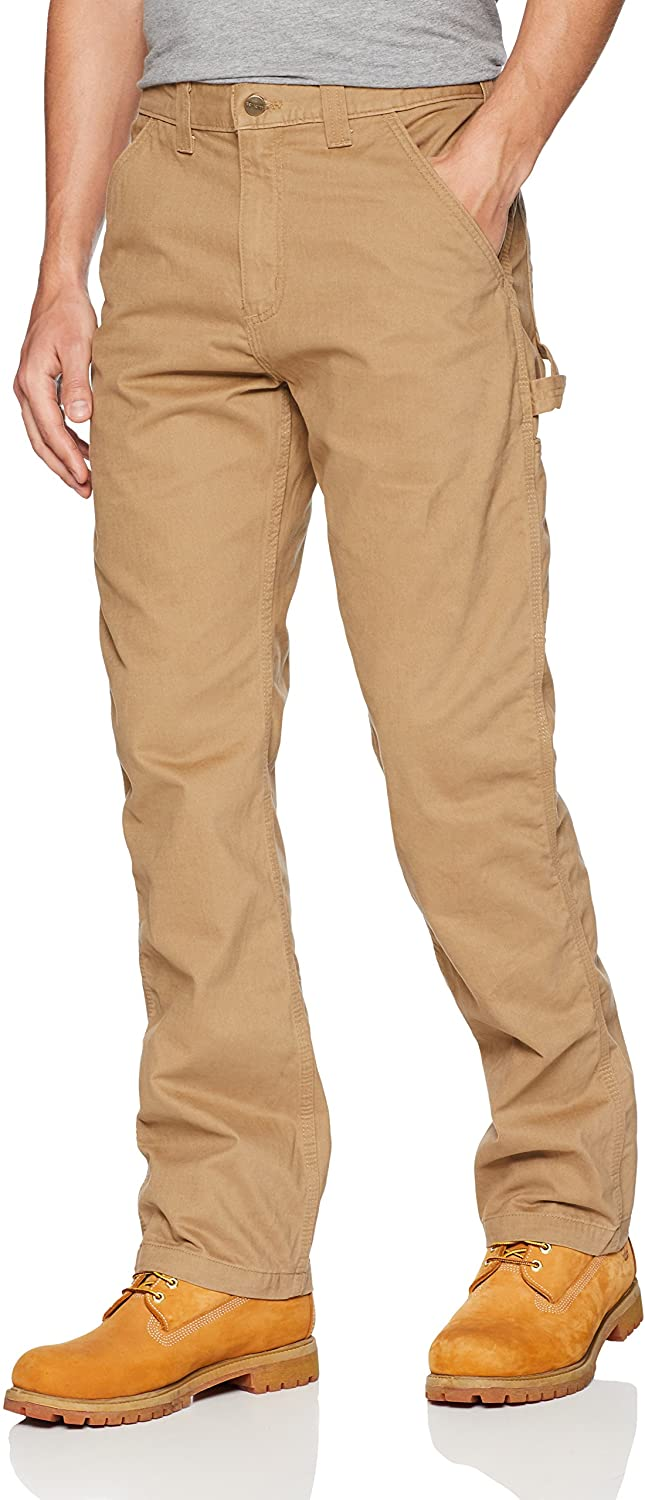Man wears Carhartt Relaxed Fit Wash Twill Dungaree Pant in light khaki color