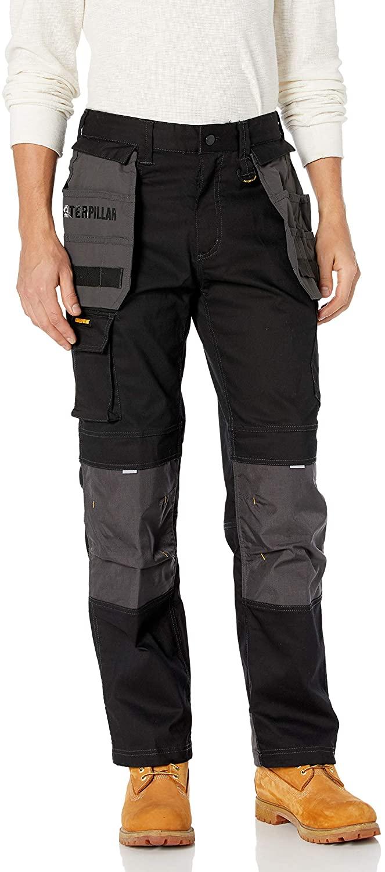 Man wears Caterpillar Men's H2O Defender Pant in black