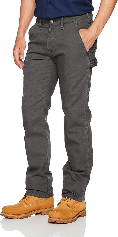 Man wears Dickies Tough Duck Carpenter pants in grey