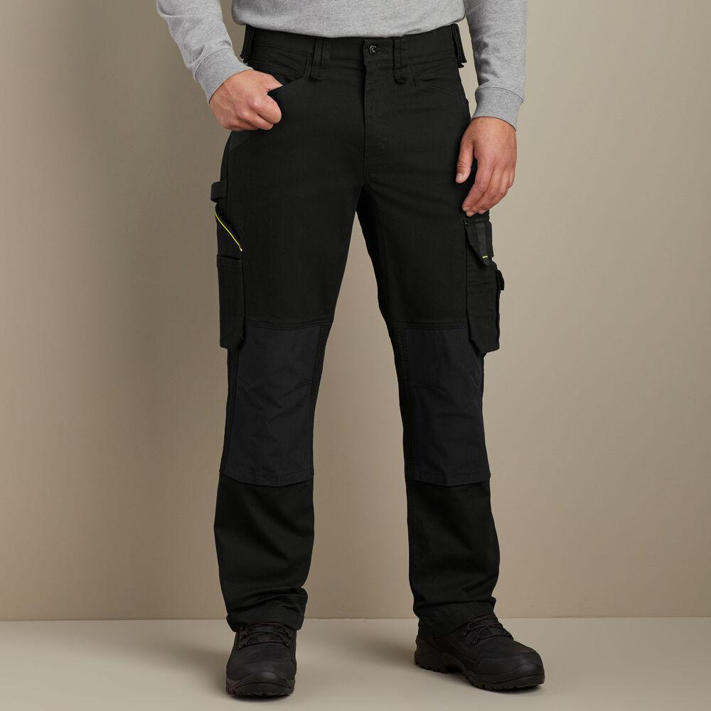 Man wears Duluth Men's TradeTek Cargo Pants in black