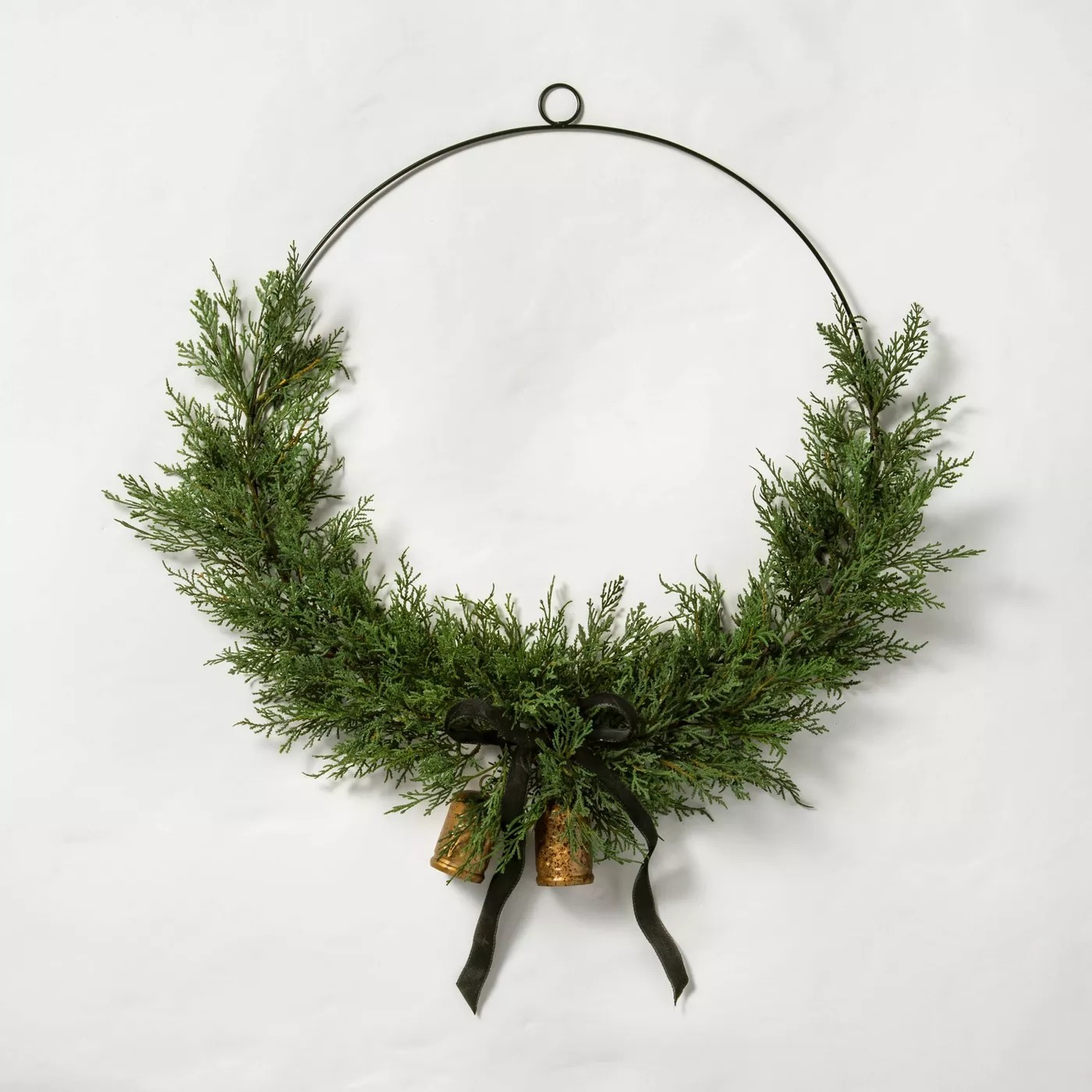 faux ceder wreath with brass bell on hoop