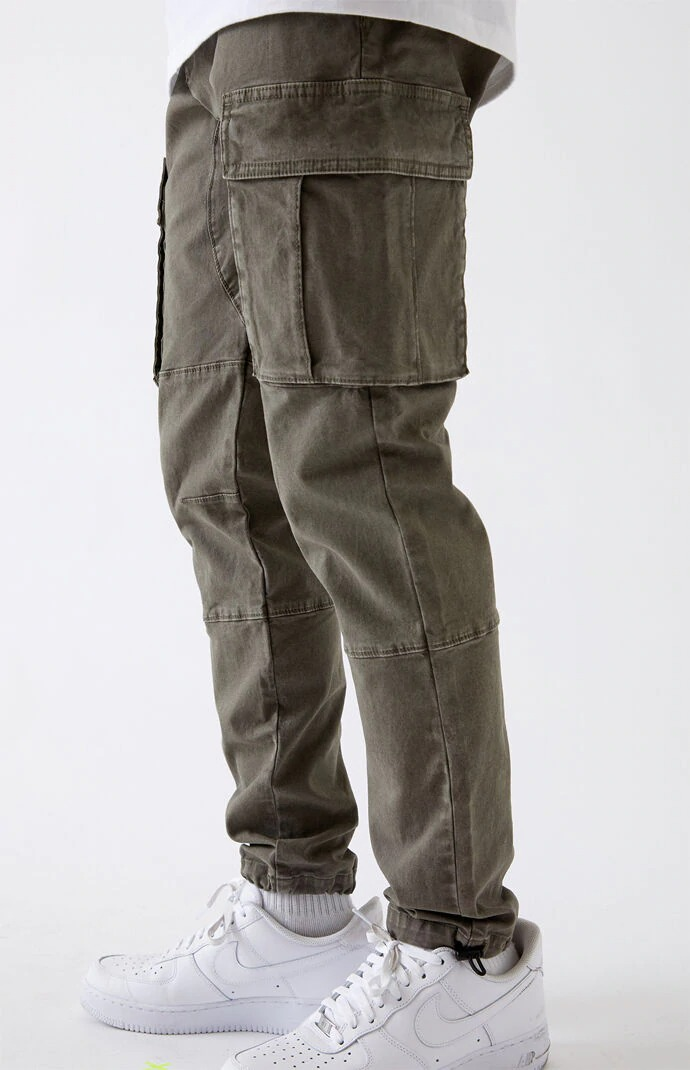 Man wears PacSun Utility Olive Slim Cargo Pants with light sneakers