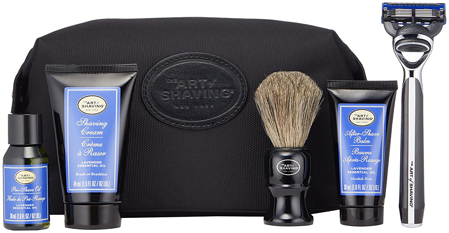 The Art of Shaving Travel Shaving Kit for Men in lavender in front of a dopp kit
