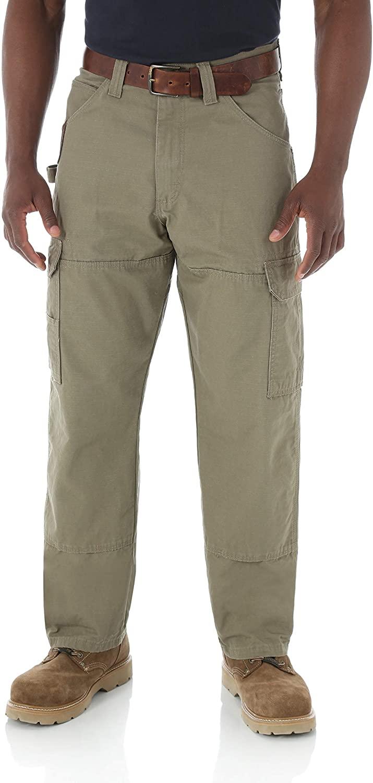 Man wears Wrangler Riggs Workwear Men's Ranger Pant in light green