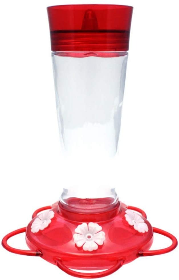 red hummingbird feeder with glass bottle