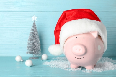 Composition with piggy bank and Christmas decor on table. Space