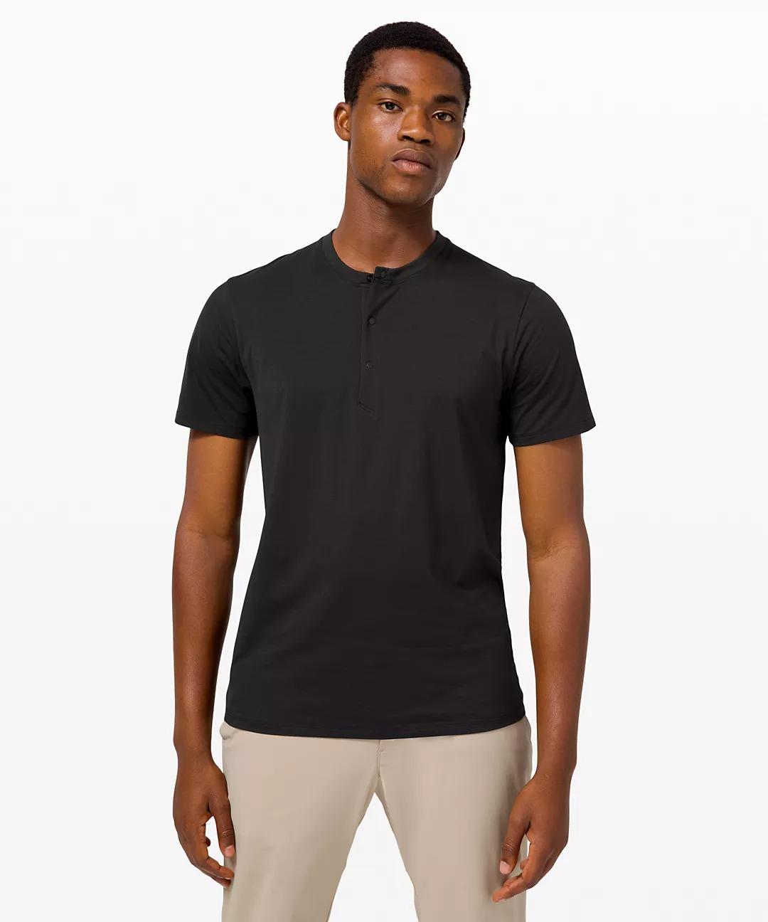 Man wears Lululemon The Fundamental Short-Sleeve Henley shirt in black