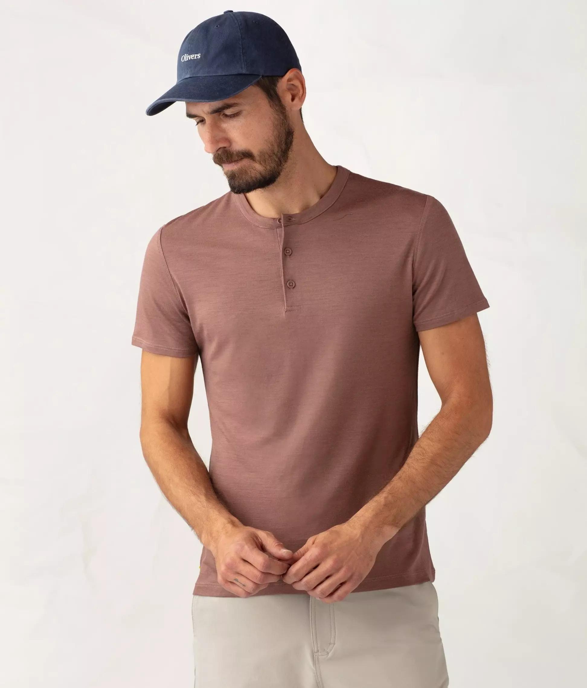 Man wears Olivers Apparel Convoy Short-Sleeve Henley shirt in terracotta