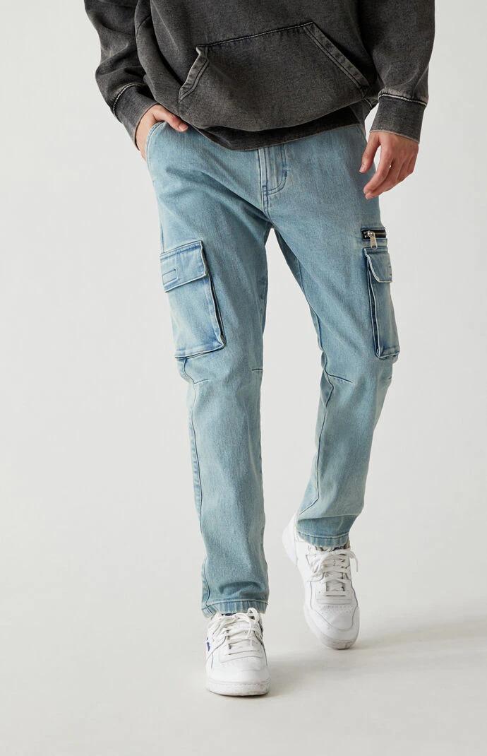 Man wears PacSun Medium Indigo Slim Taper Cargo Pants Jeans