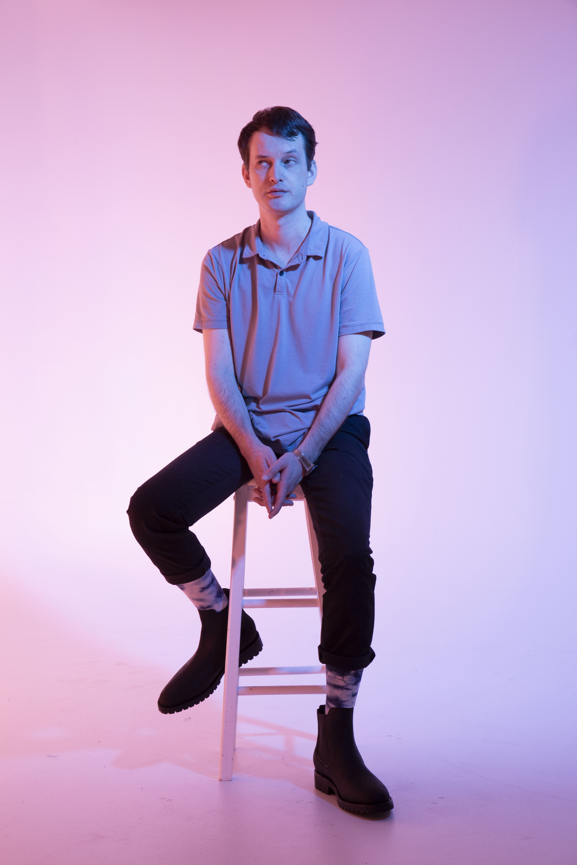 man sitting on stool, man awards 2020