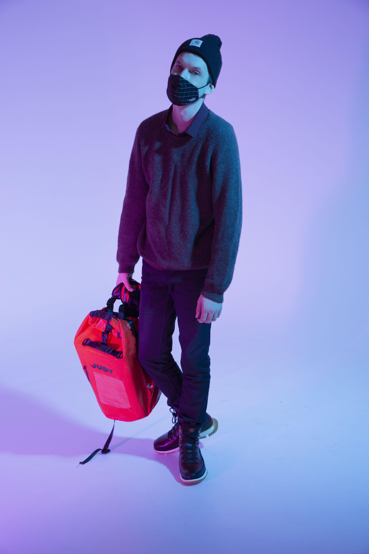 man wearing face mask holding JUDY pack, man awards 2020