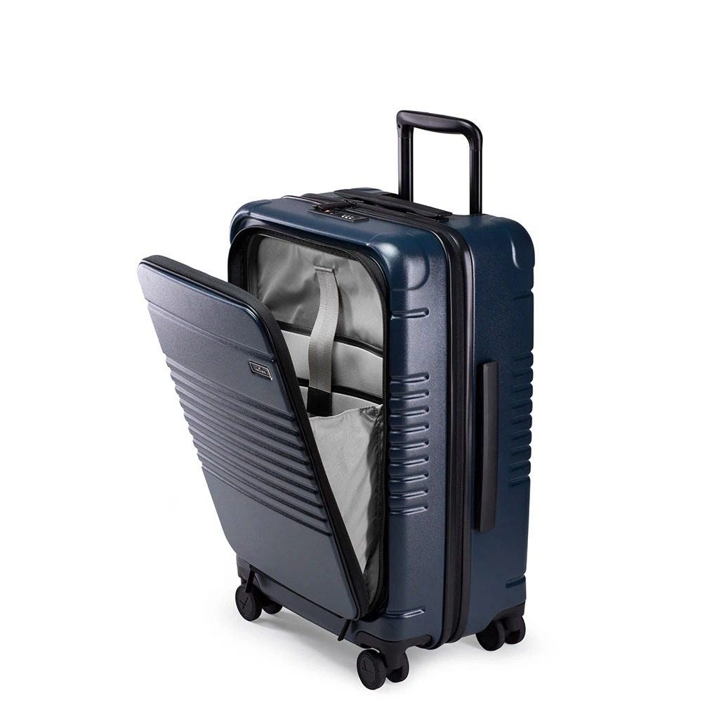Arlo Skye The Zipper Carry-On Max with Front Pocket Rolling Suitcase in blue, best rolling suitcases