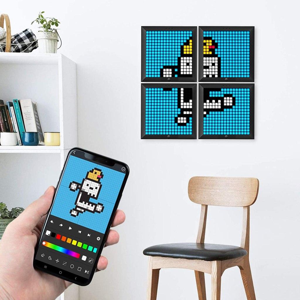 Divoom digital art frame displayed on wall