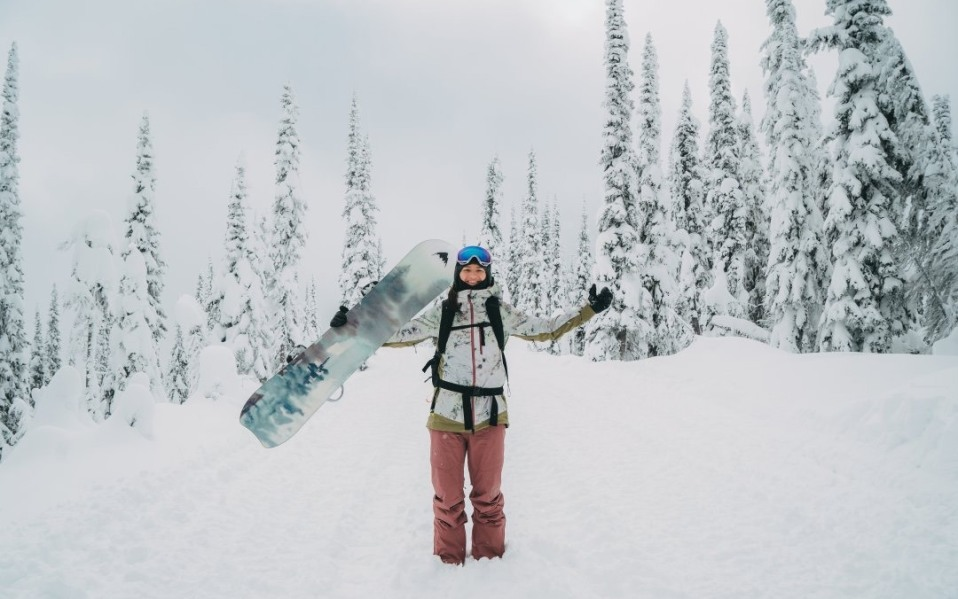 snowboarder in snow with board and