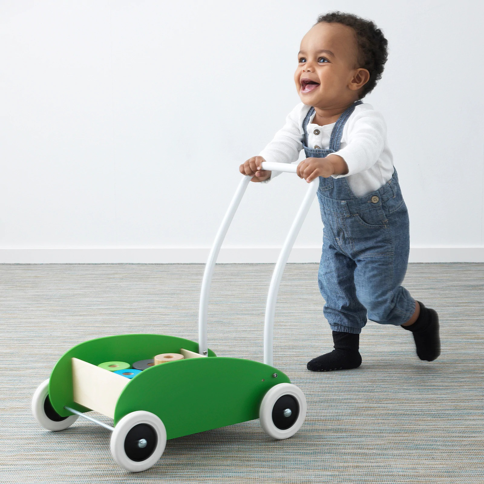 Ikea-mula-toddle-wagon-walker-green-with-toddler-using-it