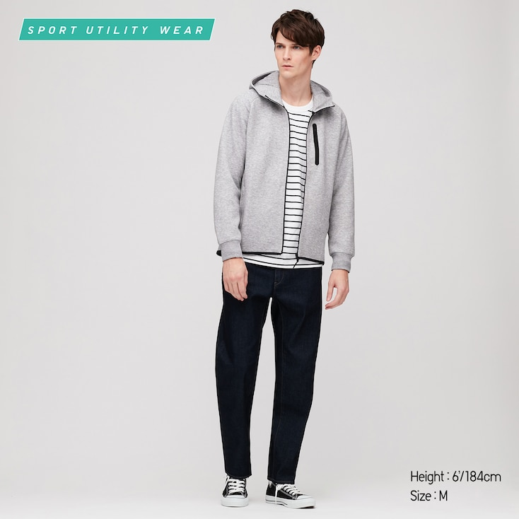 Man wears Uniqlo Dry Stretch Sweat Full Zip Hoodie in grey