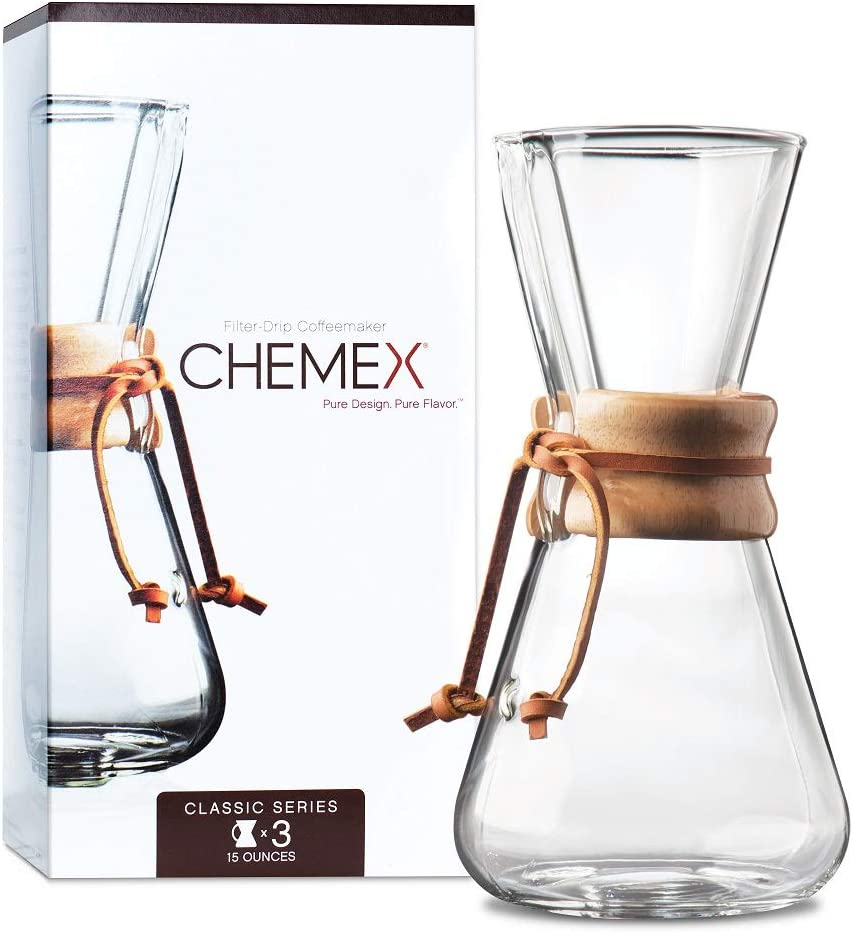A Chemex Pour-Over Glass 3-Cup Coffeemaker in front of its box