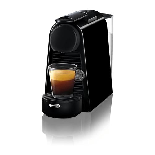 A black Nespresso Essenza Mini Espresso Machine brewing espresso