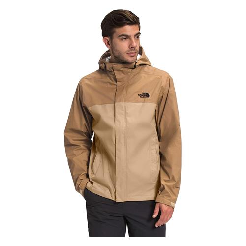 Man wears The North Face Men's Venture 2 Waterproof Hooded Rain Jacket in khaki