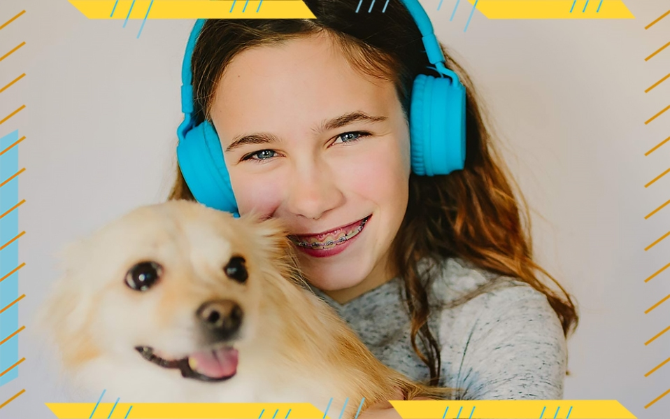 girl with purobasic headphones and dog,