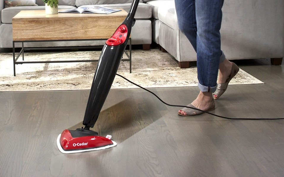 Person uses steam mop to clean