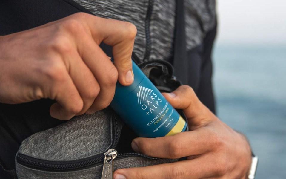 Man holds Oars + Alps deodorant