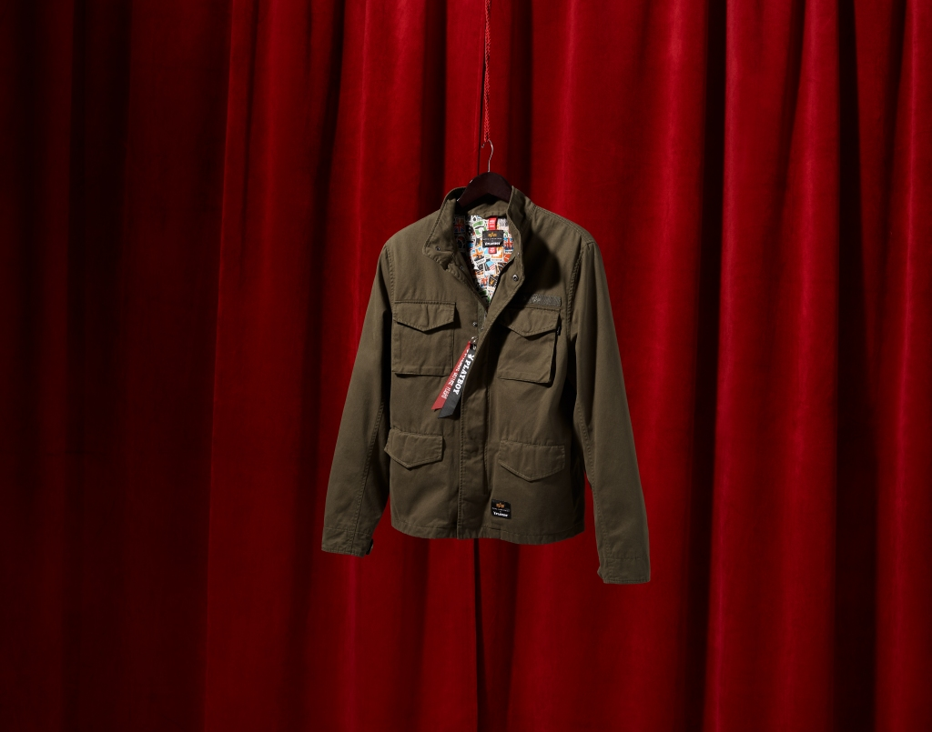 Playboy-X-Alpha-Field-Coat-limited-edition-red-drapes-background