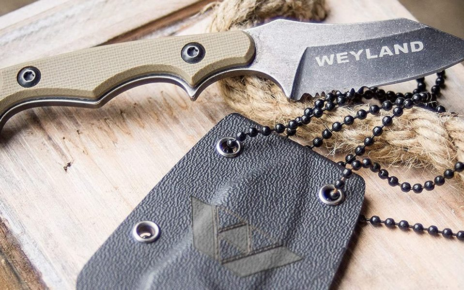 Weyland Neck Knife rests on wood