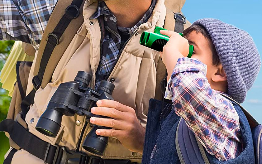young child with binoculars