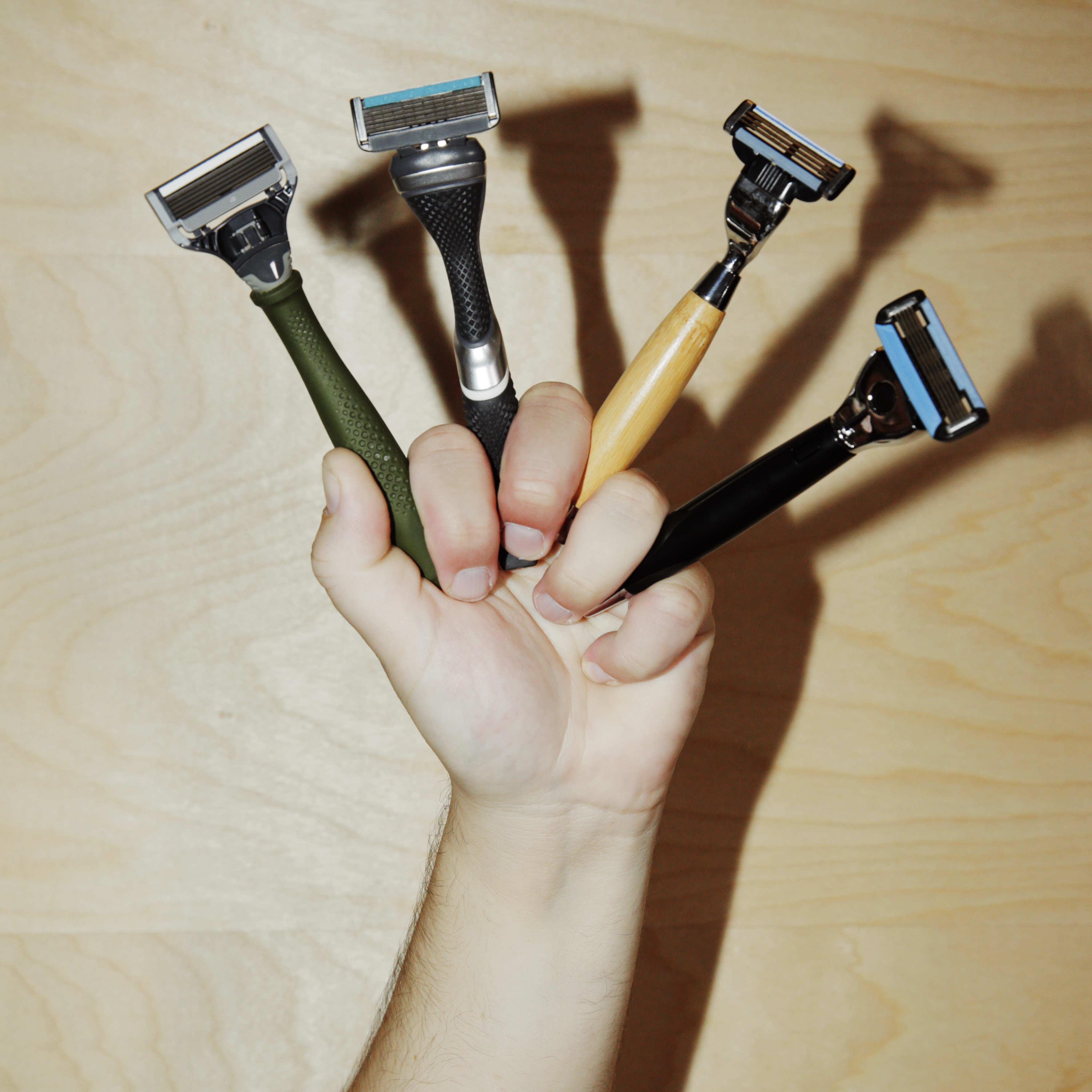various razors on a hand
