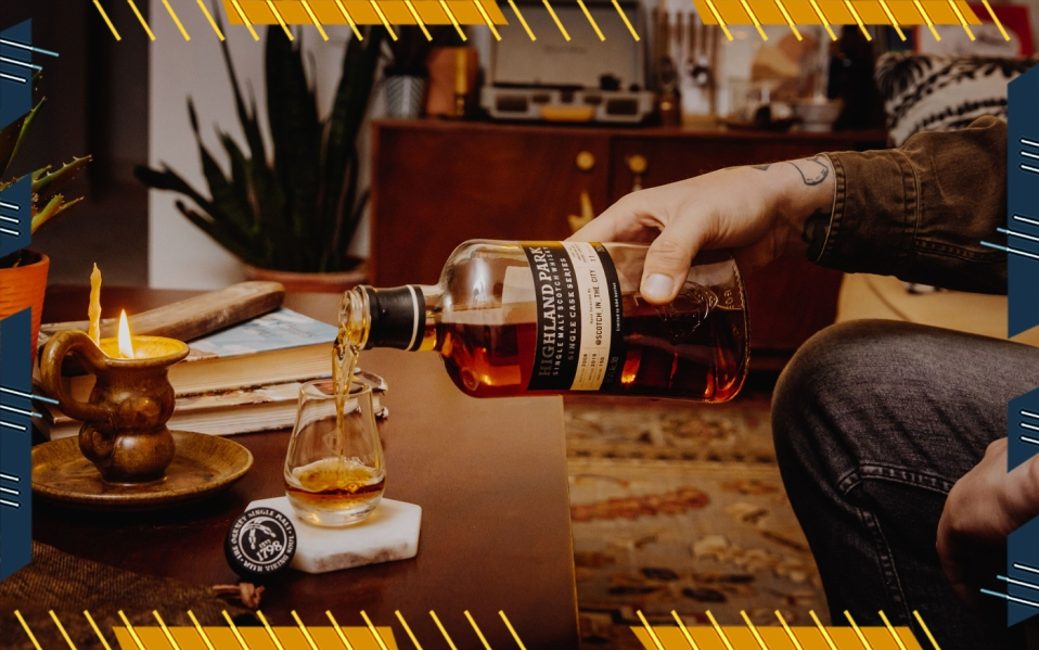 man pouring highland park scotch whisky