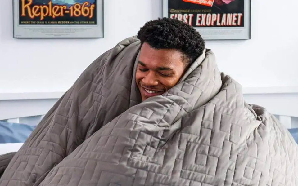 man-under-gravity-blanket