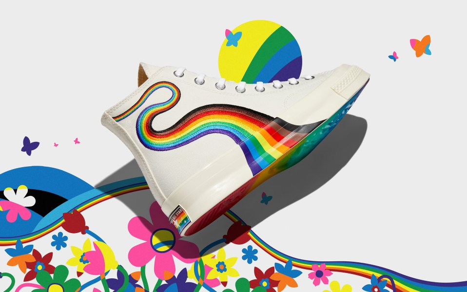converse pride sneakers on rainbow background