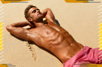 man tanning on the sand