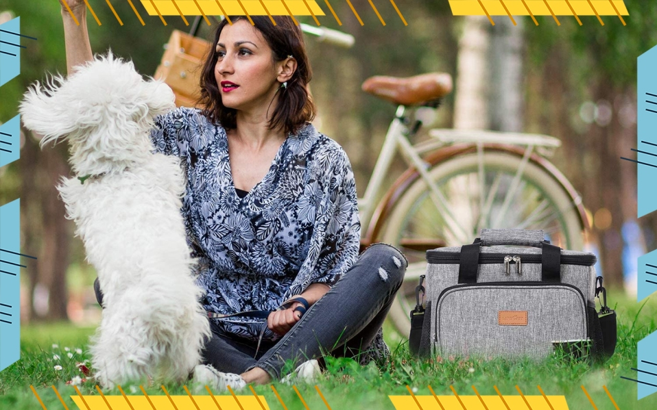 woman with dog and insulated cooler