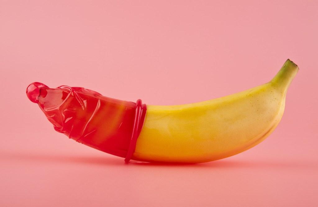 red condom on banana