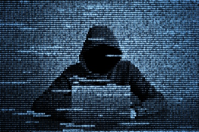 Hacker in data security concept. Hacker using laptop. Hacking the Internet. Cyber attack.
