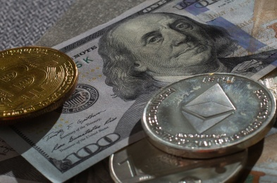Bitcoin cryptocurrency and banknotes of one US dollar