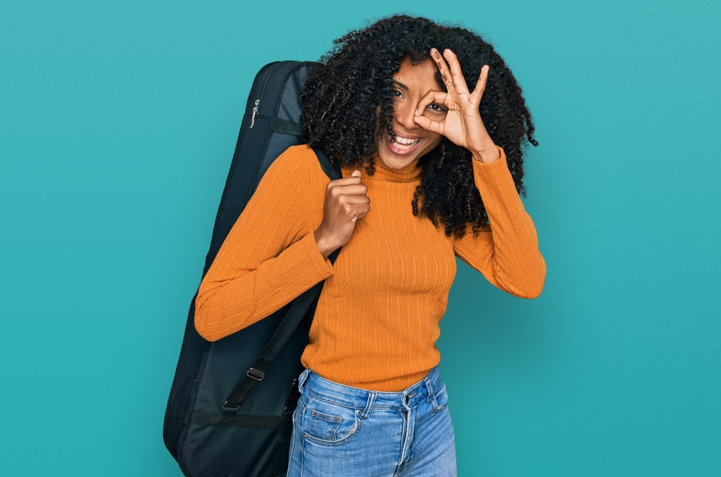 woman with guitar travel case