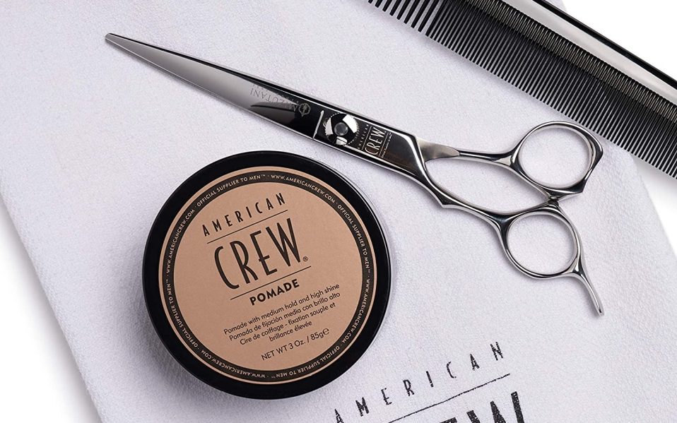 American Crew Pomade sits on towel