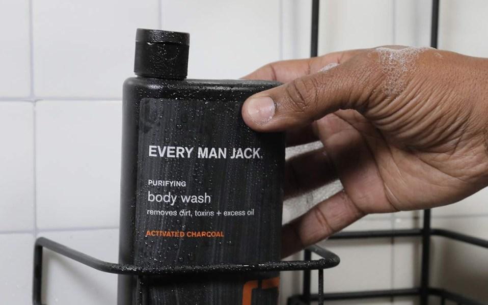 Man in shower grabs bottle of
