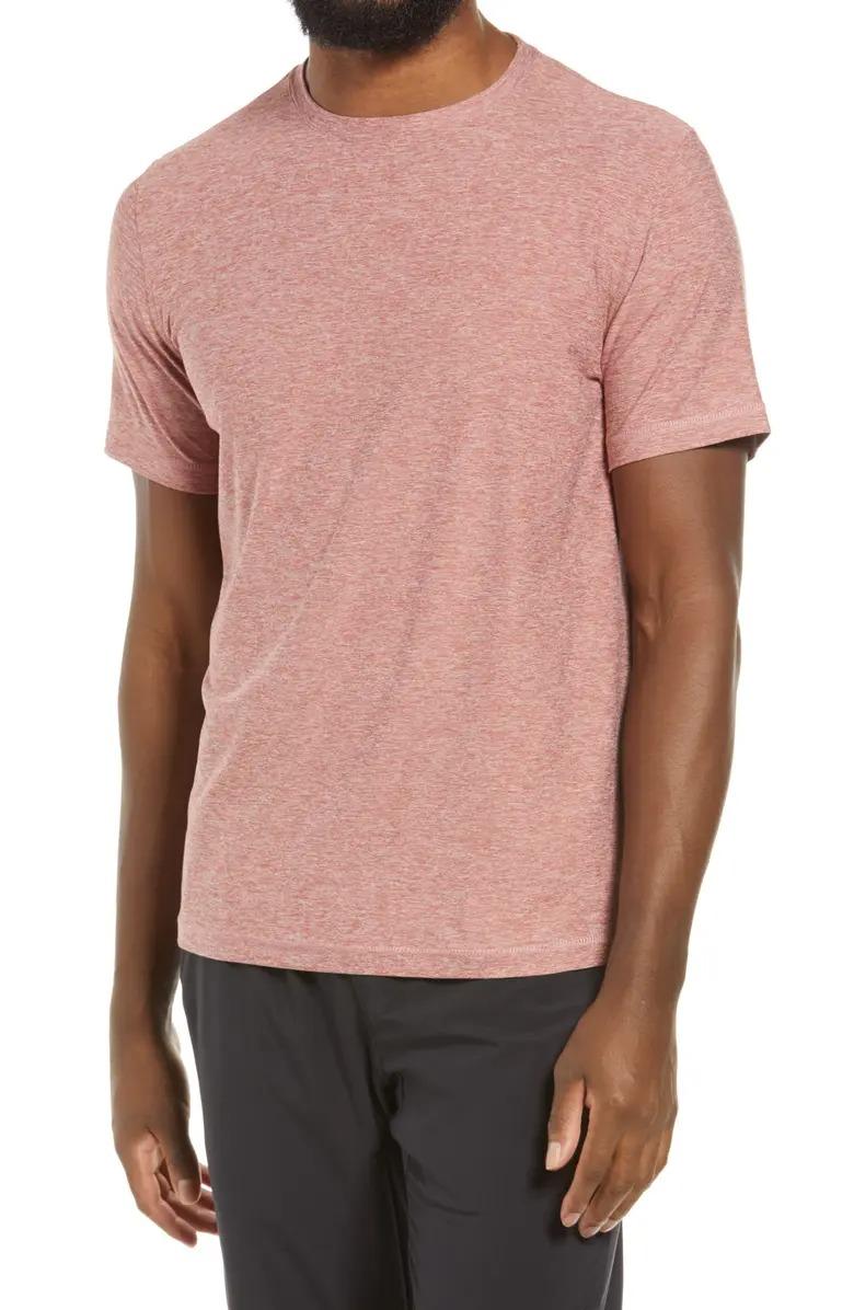 Man wears Vuori Strato Slim Fit Crewneck Tech T-Shirt