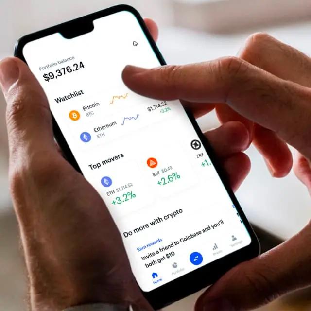 man using coinbase app on phone