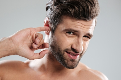 man-with-finger-in-ear