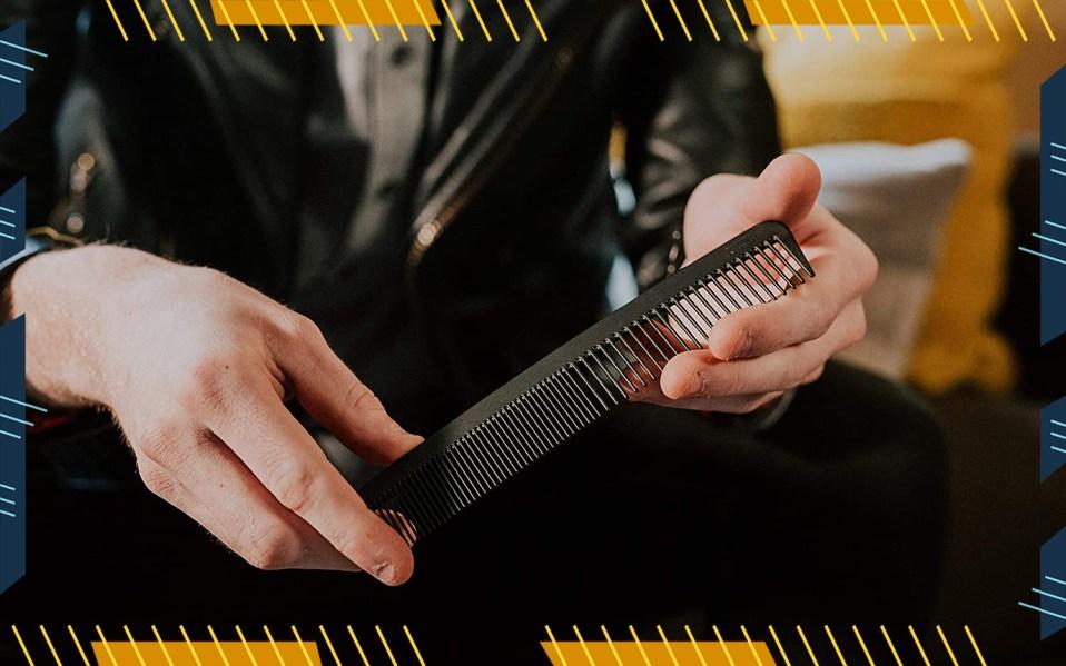 man holding metal combs