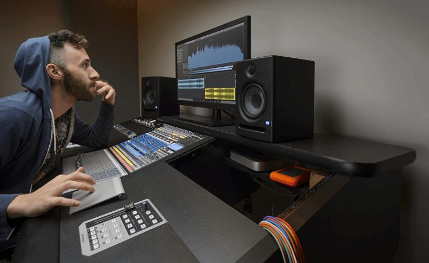 guy at studio mixing music using