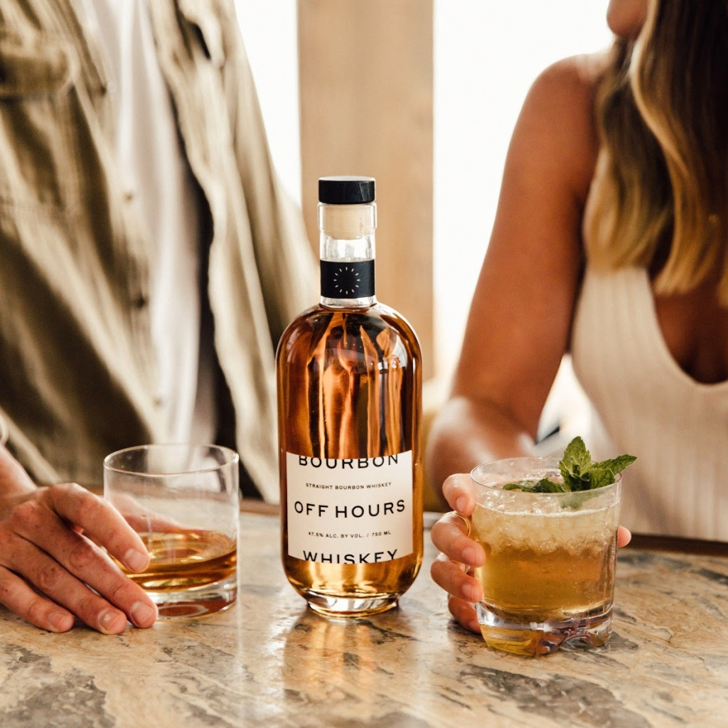 man and woman drinking off hours bourbon in bar