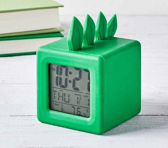 Kids alarm clock shaped like a dinosaur