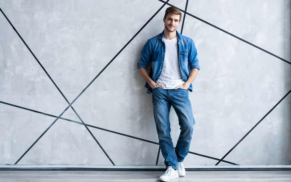 White Man wearing jeans standing up