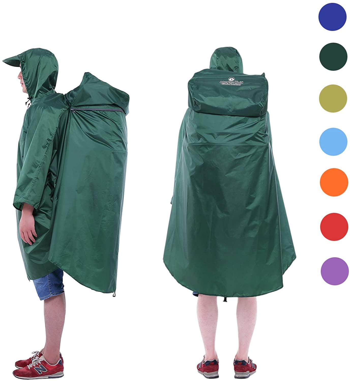 Person wears Adventure World Globotrekker Lightweight Backpack Poncho in green; best backpack rain covers
